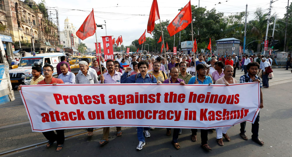 People hold a banner during a protest after the government scrapped the special status for Kashmir, in Kolkata, India, August 5, 2019