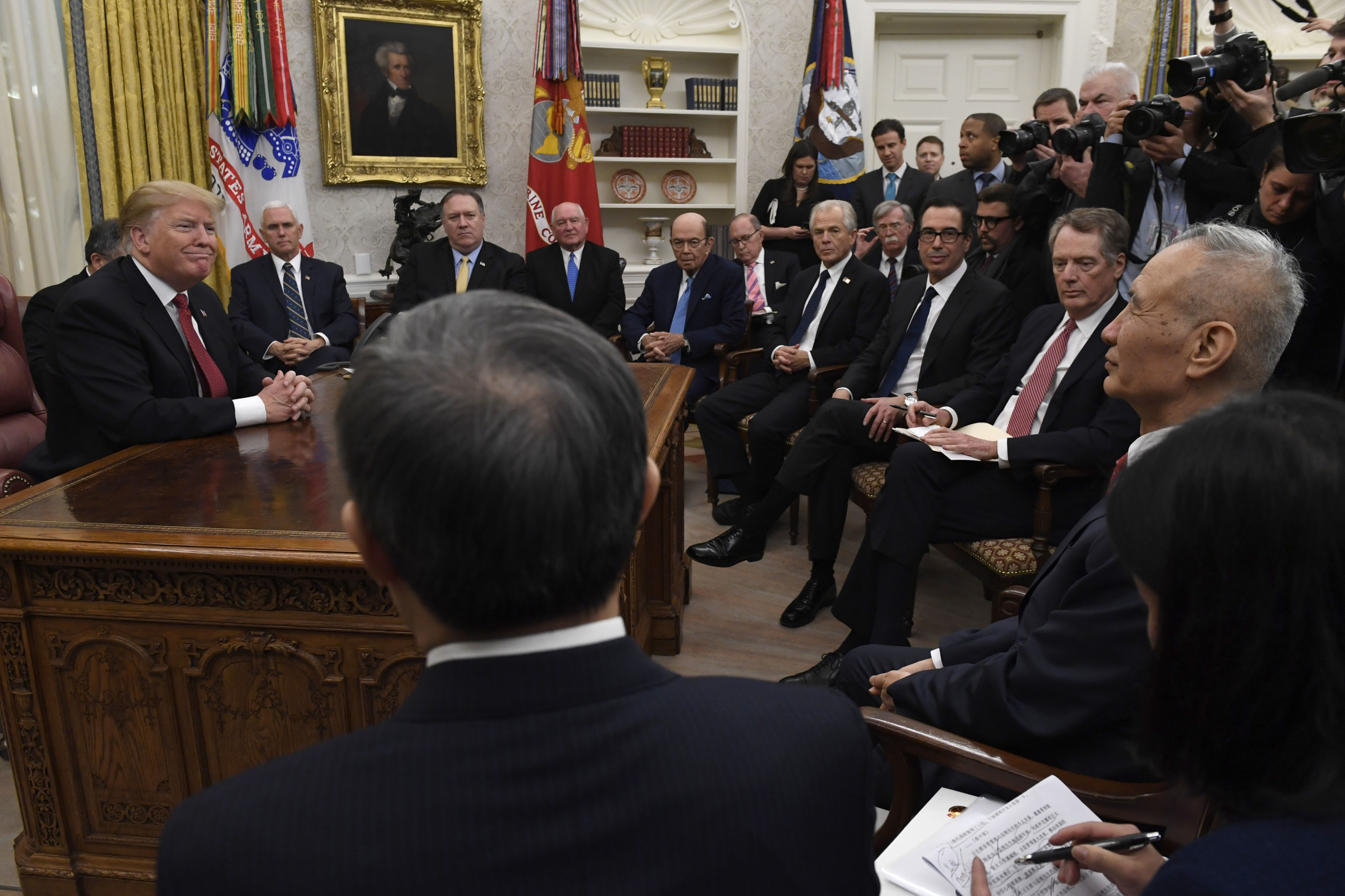 President Donald Trump, left, holds a meeting with Chinese Vice Premier Liu He, right, in the Oval Office of the White House in Washington, Thursday, Jan. 31, 2019