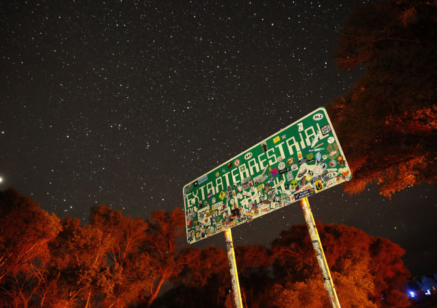 In this July 22, 2019 photo, a sign advertises state route 375 as the Extraterrestrial Highway, in Crystal Springs, Nev. The road boarders the Nevada Test and Training Range, the location of Area 51