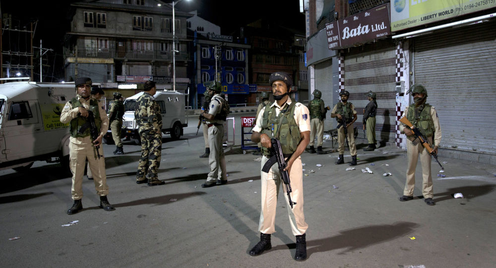 Indian soldiers stand guard in Srinagar, India, Sunday, Aug. 4, 2019