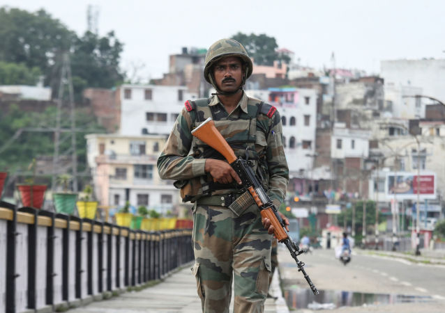 An Indian army soldier patrols on a bridge during restrictions in Jammu, August 5, 2019