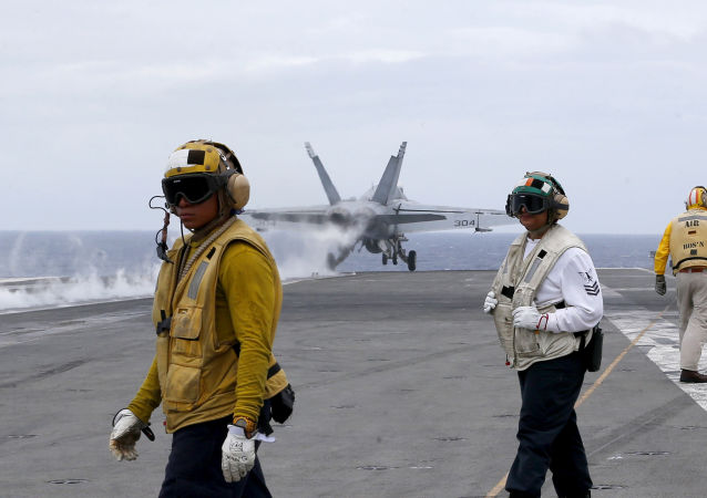 A U.S. fighter jet takes off from the U.S. aircraft carrier USS Ronald Reagan for their patrol at the international waters off South China Sea Tuesday, Aug. 6, 2019