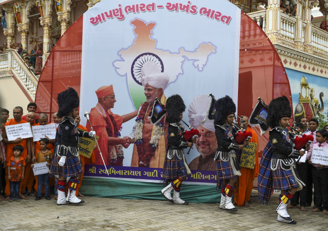 Pipe band members of the lord Shree Muktajivan Swamibapa perform as they participate in celebrations after the Indian government has revoked special autonomy to Indian-administered Kashmir, at the spiritual centre 'Maninagar Shree Swaminarayan Gadi Sansthan' in Ahmedabad, on August 6, 2019