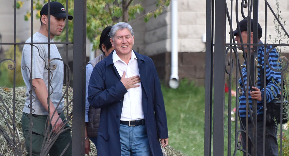 In this file photo taken on June 27, 2019 Former Kyrgyz president Almazbek Atambayev stands at the entrance to his residence in the village of Koi-Tash near the capital Bishkek