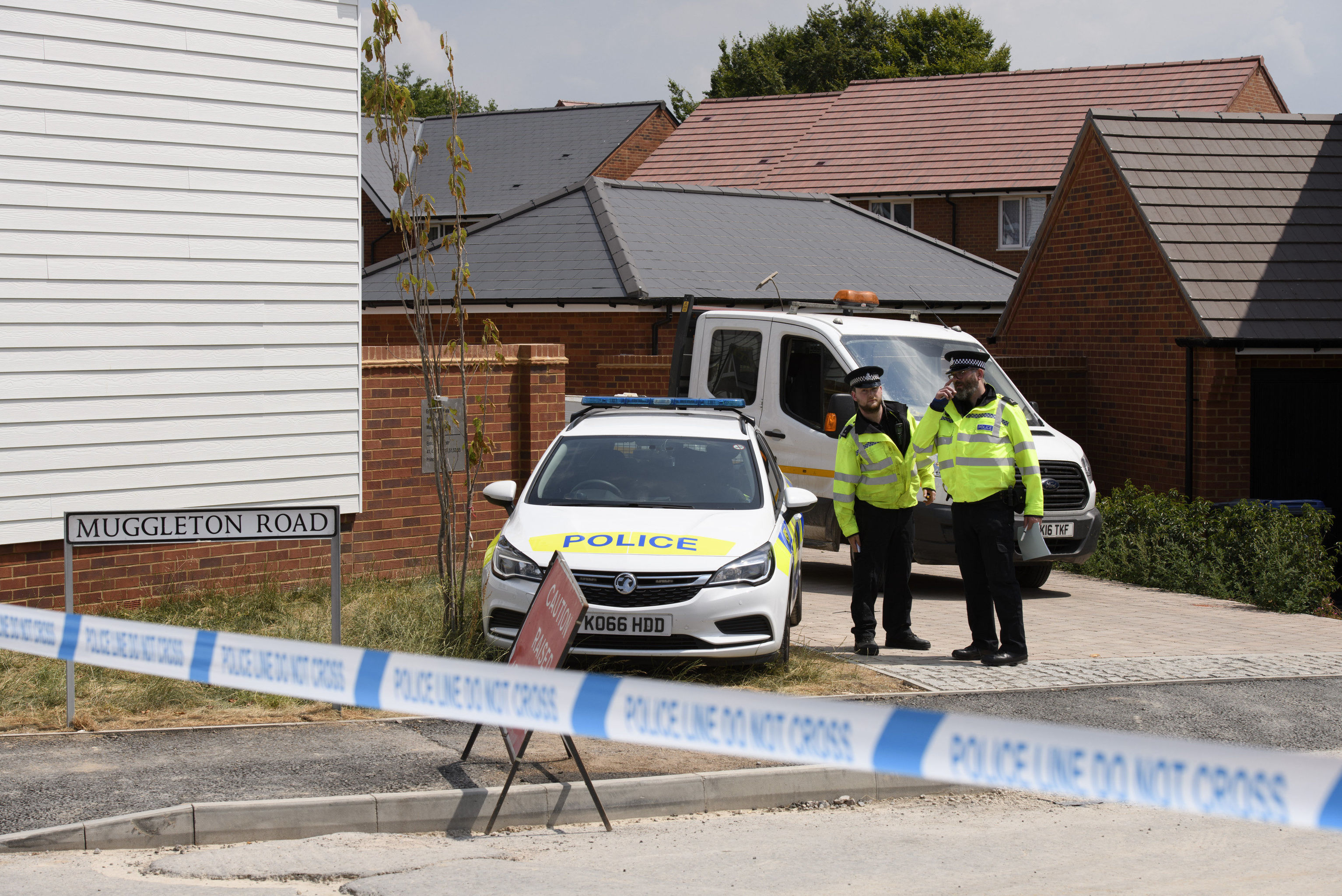 Policemen are outside the nerve agent victim Charlie Rowley in Amesbury, Wiltshire