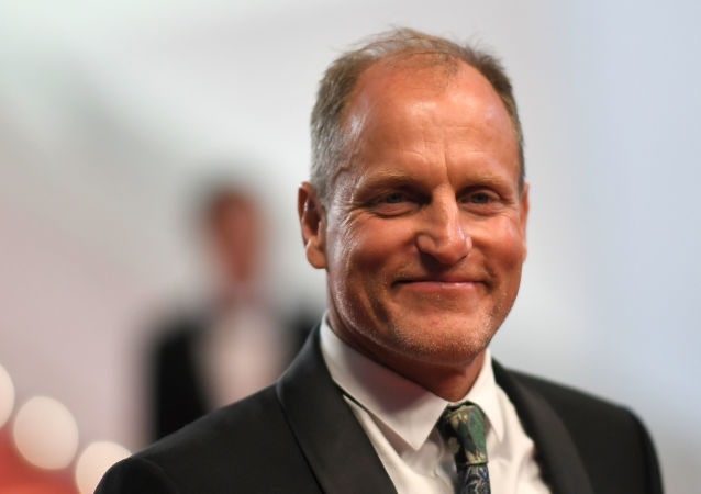 US actor Woody Harrelson poses as he leaves the Festival Palace on May 15, 2018 after the screening of the film Solo : A Star Wars Story at the 71st edition of the Cannes Film Festival in Cannes, southern France