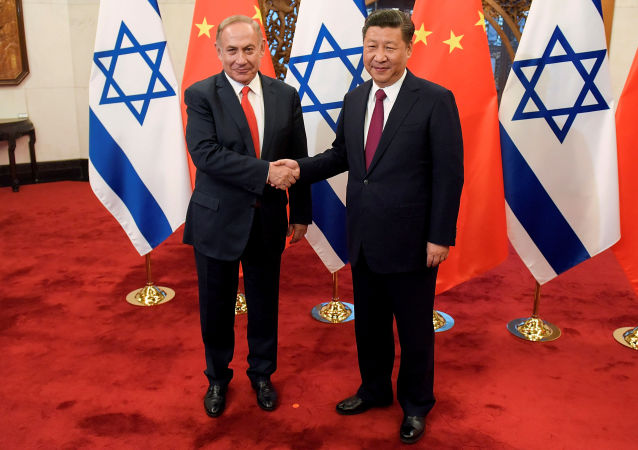 Chinese President Xi Jinping and Israeli Prime Minister Benjamin Netanyahu shake hands ahead of their talks at Diaoyutai State Guesthouse in Beijing, China March 21, 2017
