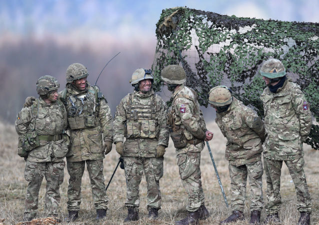 British artillery soldiers react during the 'Dynamic Front 18' exercise in Grafenwoehr, near Eschenbach, southern Germany, on March 7, 2018. 'Dynamic Front 18' is US Army's largest annual artillery exercise in Europe, including more than 3,700 participants from 27 nations.