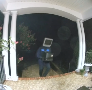 Individual donning TV set as a mask/helmet delivered televisions to people's front doors in Virginia
