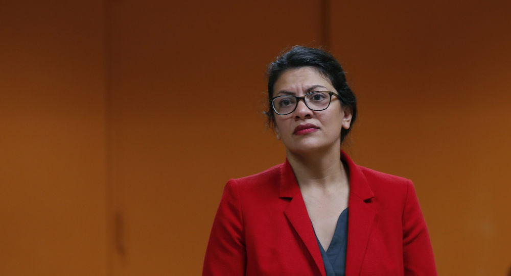 U.S. Rep. Rashida Tlaib, D-Mich., listens to a constituent in Wixom, Mich., Thursday, Aug. 15, 2019.
