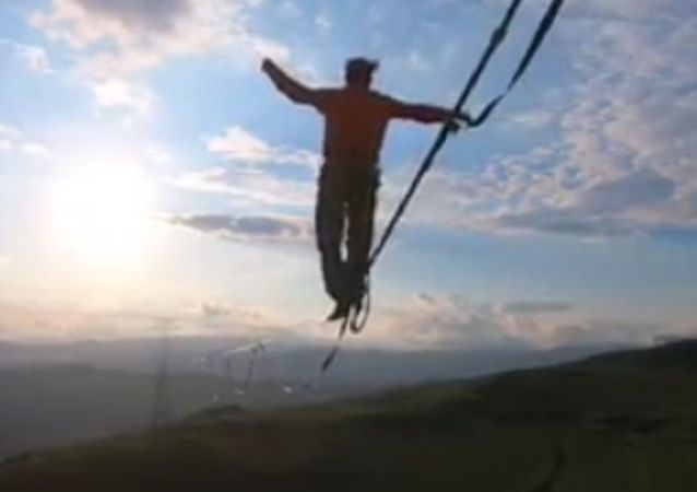 A professional slackliner Friedrich Kühne from Germany has filmed stunning mid-air 1050 feet (320 meters) walk between two power transmission towers in Armenia during 70 mph winds