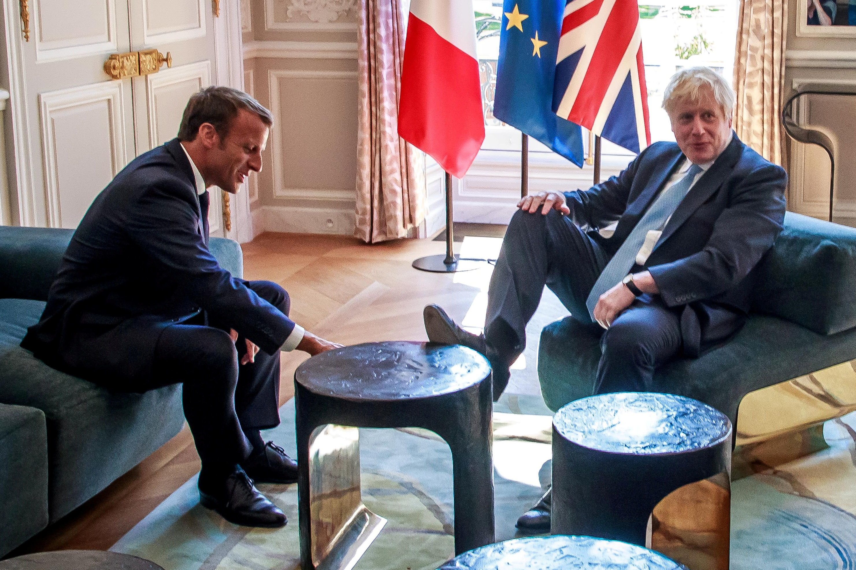 French President Emmanuel Macron and British Prime Minister Boris Johnson speak during a meeting at the Elysee Palace in Paris, France, August 22, 2019.