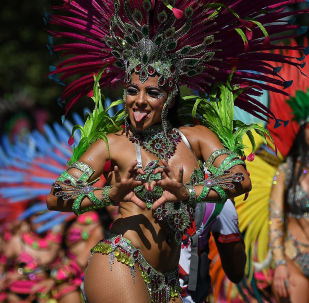 Performers in costumes take part in the carnival on the main Parade day of the Notting Hill Carnival in west London on August 26, 2019.