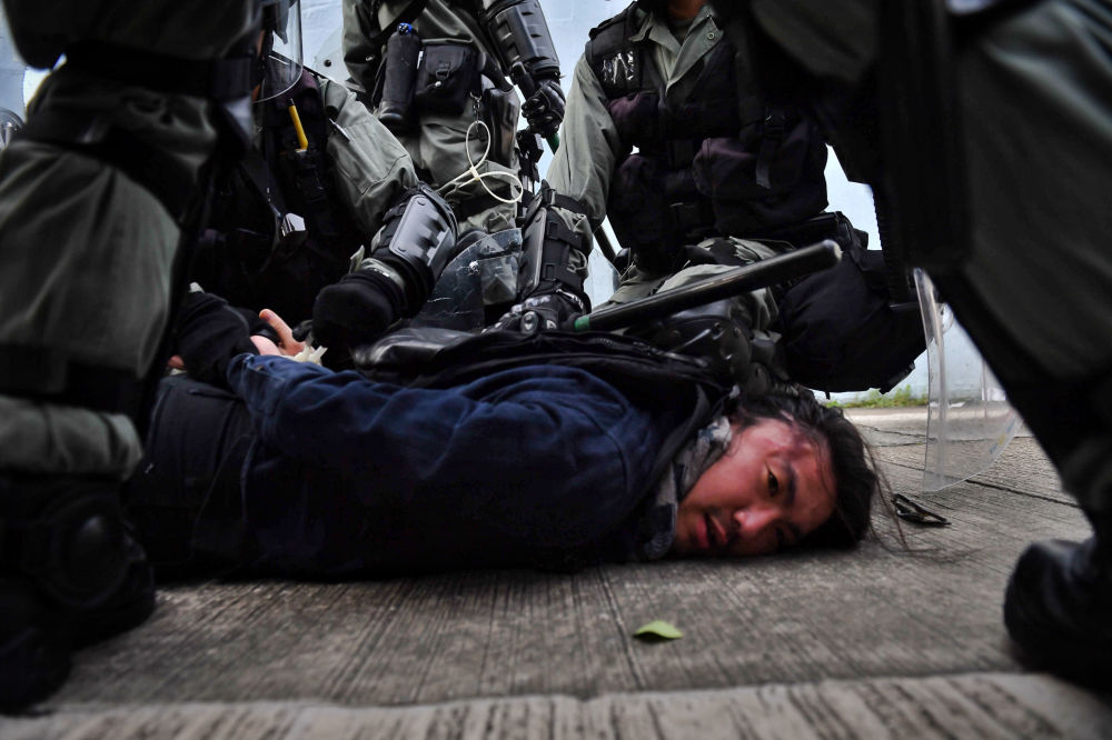 Riot police detain a protester at Kowloon Bay in Hong Kong on August 24, 2019