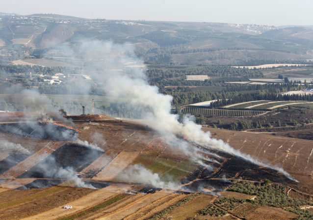 Smoke rises from shells fired from Israel in Maroun Al-Ras village, near the border with Israel, in southern Lebanon, September 1, 2019.