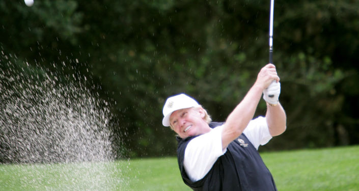 Donald Trump hits out of the sand on the first hole of the Poppy Hills Golf Course