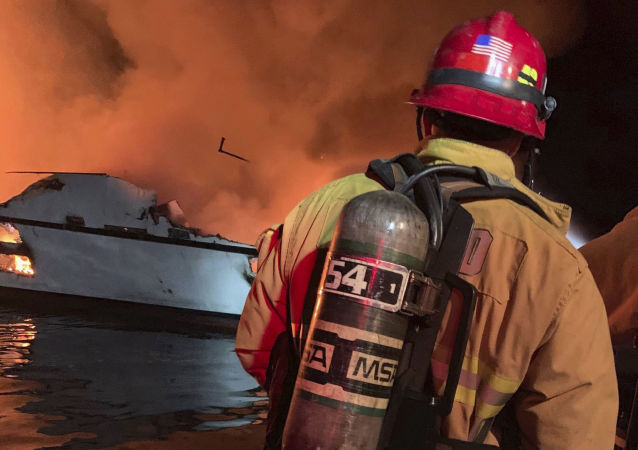 In this photo provided by the Ventura County Fire Department, VCFD firefighters respond to a boat fire off the coast of southern California, Monday, Sept. 2, 2019
