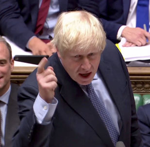 Britain's Prime Minister Boris Johnson gestures as he speaks during the weekly question time parliamentary debate in London, 4 September 2019