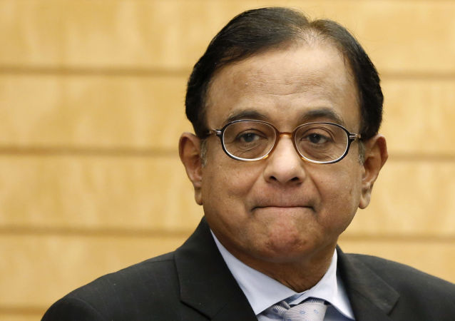 India's Finance Minister Palaniappan Chidambaram waits for arrival of Japan's Prime Minister Shinzo Abe before their meeting at Abe's official residence in Tokyo Monday, April 1, 2013