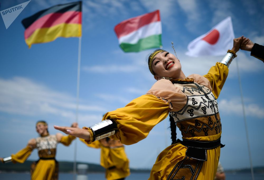 Dancers wearing national costumes perform during an exhibition at the Fifth Eastern Economic Forum on Russky Island in Vladivostok
