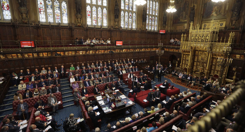 Lord Norman Fowler, the new Lord Speaker, left, speaks in the House of Lords chamber during his first sitting, in Parliament, London, Monday, Sept. 5, 2016