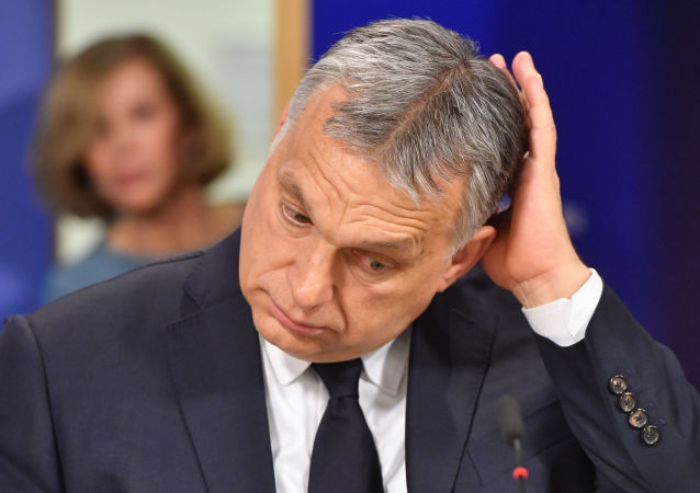 Hungary's Prime Minister Victor Orban addresses a press conference at the end of a European People's Party (EPP) meeting at the European Parliament in Brussels on March 20, 2019