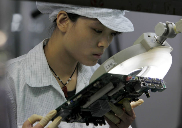 A staff member works on the production line at the Foxconn complex in the southern Chinese city of Shenzhen, Southern city in China, Wednesday, May 26, 2010
