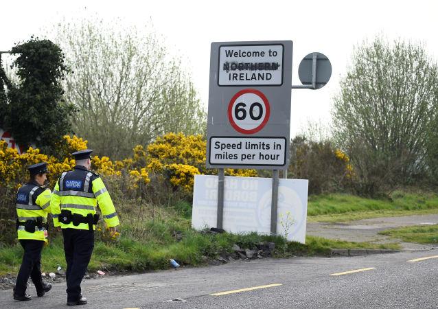 FILE PHOTO: Irish police officers patrol before U.S. House Speaker Nancy Pelosi's visit to the border between Ireland and Northern Ireland in Bridgend, Ireland, April 18, 2019