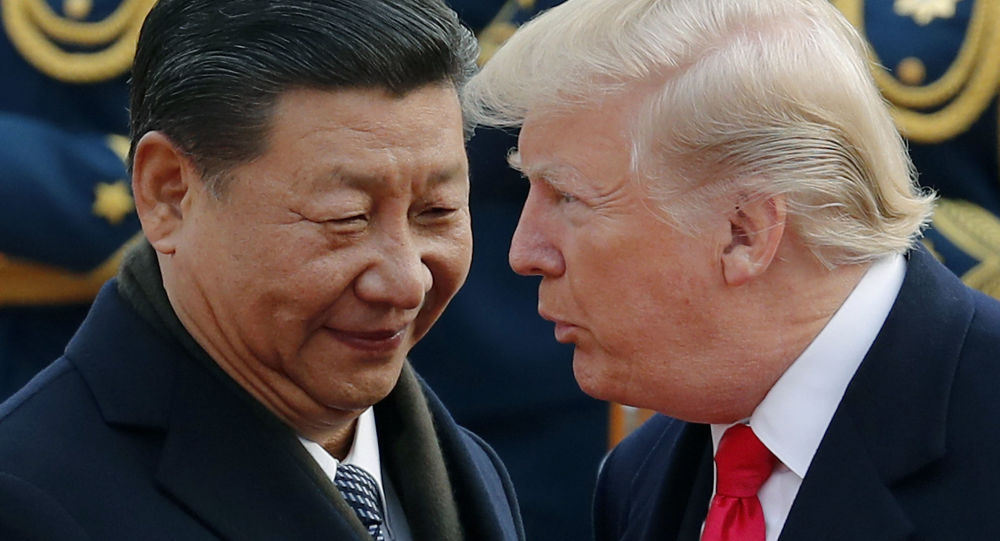 FILE - In this Nov. 9, 2017, file photo, U.S. President Donald Trump, right, chats with Chinese President Xi Jinping during a welcome ceremony at the Great Hall of the People in Beijing