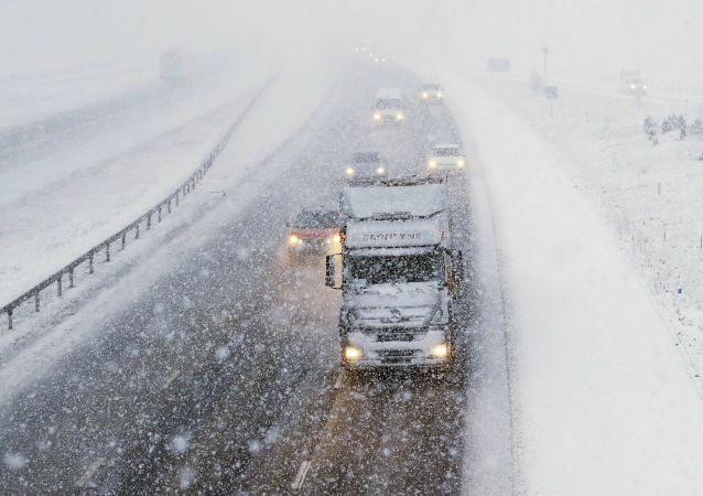 Traffic travels through snow on the M6 motorway near the village of Shap in Cumbria in January 2019.