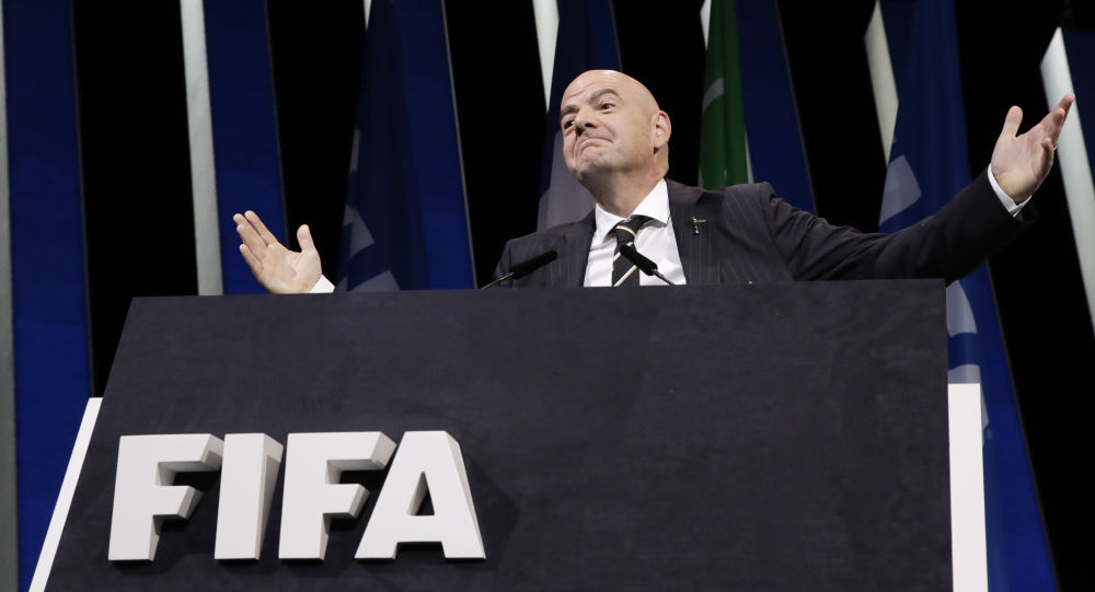 FIFA President Gianni Infantino gestures as he walks on the stage before the start of the 69th FIFA congress in Paris, Wednesday, June 5, 2019.