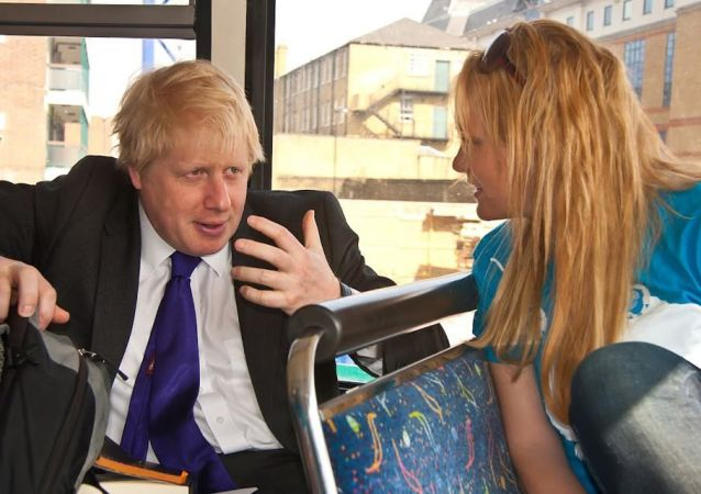 Boris Johnson and Jennifer Arcuri speak on a campaign bus in 2012.