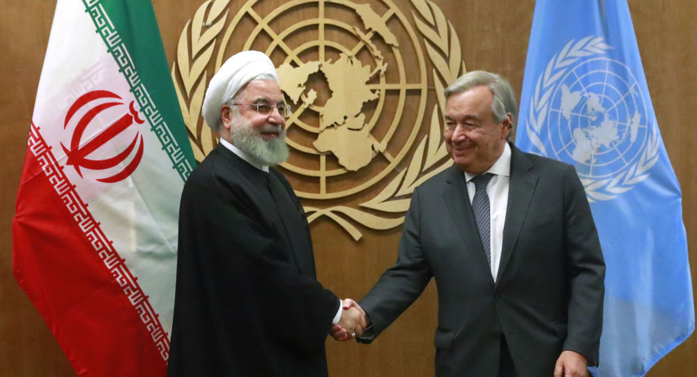 Iran's President Hassan Rouhani shakes hands with United Nations Secretary General Antonio Guterres as they meet on the sidelines of the 74th session of the United Nations General Assembly at U.N. headquarters in New York City