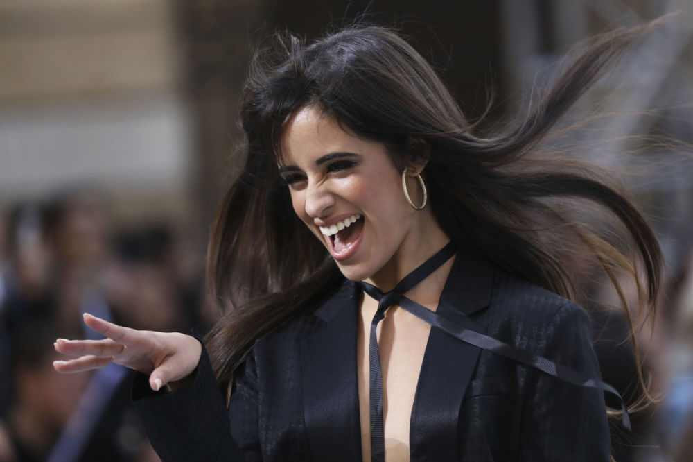 Singer Camila Cabello wears a creation as part of the L'Oreal Ready To Wear Spring-Summer 2020 collection, unveiled during the fashion week, in Paris, Saturday, Sept. 28, 2019.
