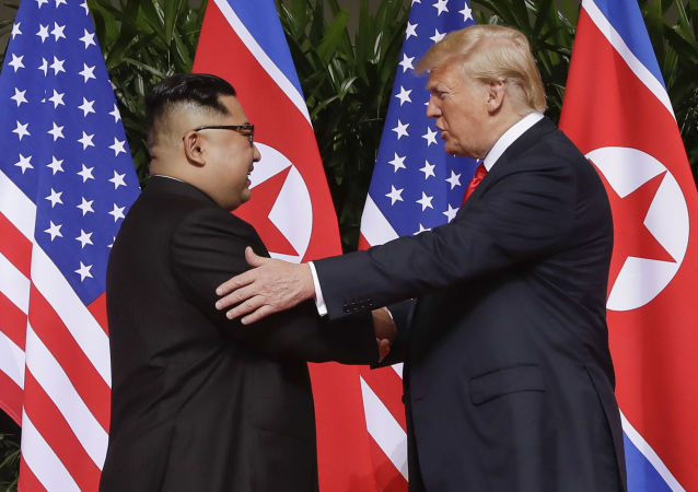 n this June 12, 2018 file photo, U.S. President Donald Trump, right, shakes hands with North Korea leader Kim Jong Un at the Capella resort on Sentosa Island in Singapore. Kim's fifth meeting with Chinese President Xi Jinping continues his ambitious diplomatic outreach that has included summits with the leaders of the United States, South Korea and Russia in the past year and a half. Experts say Kim is attempting to form a united front with North Korea's main ally China to strengthen his leverage in the stalled nuclear negotiations with the United States.