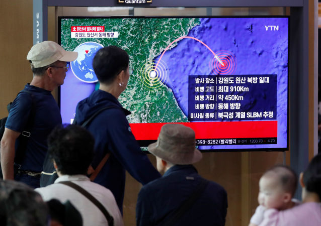 People watch a TV broadcasting a news report on North Korea firing a missile that is believed to be launched from a submarine, in Seoul, South Korea, October 2, 2019