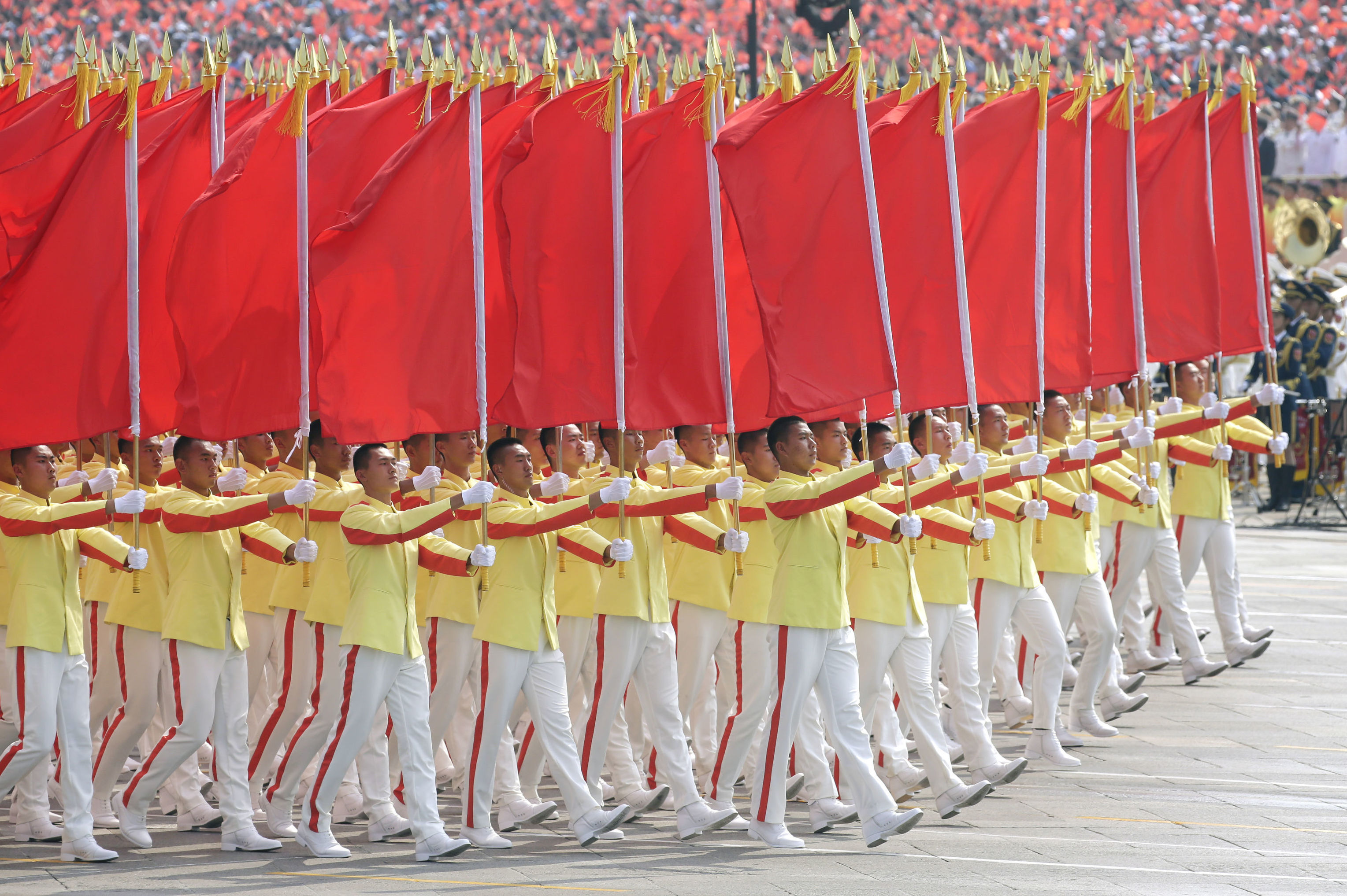Performers carrying red flags take part in the parade marking the 70th founding anniversary of People's Republic of China, on its National Day in Beijing, China October 1, 2019
