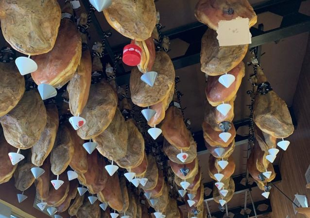 Jamon Hanging From the Ceiling in a Shop in Spain