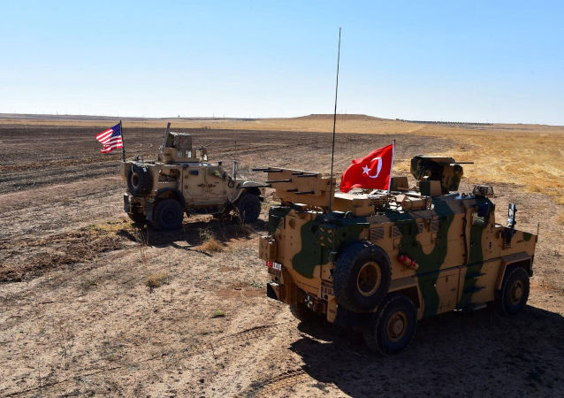 Turkish and U.S. military vehicles are seen on the Syrian-Turkish border during a joint U.S.-Turkey patrol near Tel Abyad, Syria, September 8, 2019