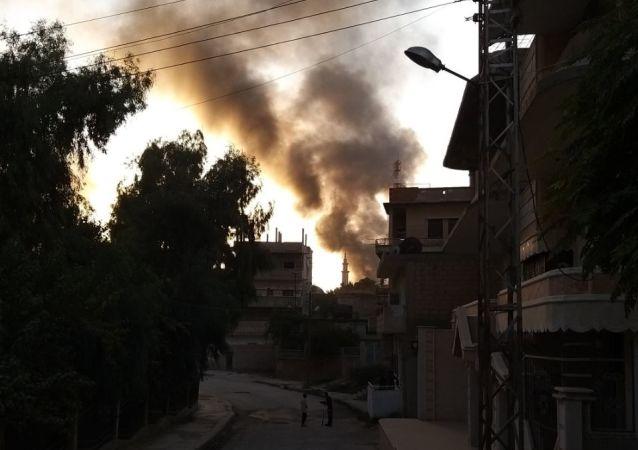 Smoke is seen billowing in Ras al-Ain