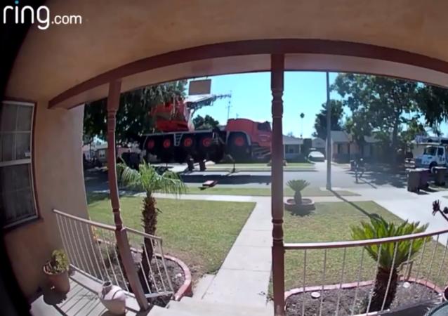 Home Security Camera Records Shocking Moment Crane Topples Onto US Homes