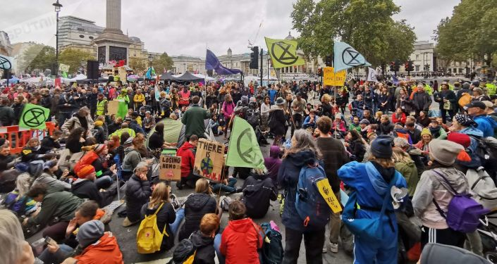 Extinction Rebellion activists block a major thruway to obstruct traffic during a major rally near Trafalgar Square in London, UK on Friday, 11 October 2019