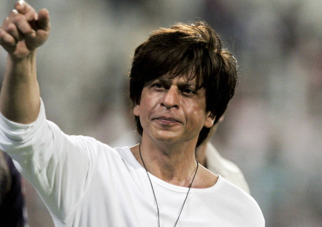 Shah Rukh Khan, Bollywood actor and Kolkata Knight Riders co-owner, gestures to people in a stadium after his team won a match against the Mumbai Indians at the VIVO IPL cricket T20 match in Kolkata, India, 28 April 2019