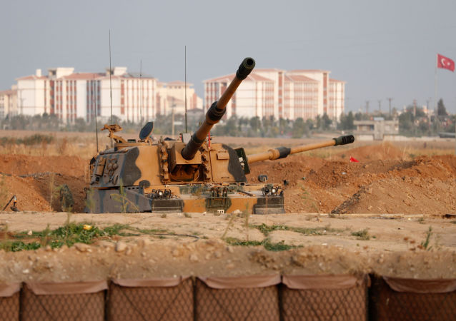 A Turkish army howitzer is positioned near the Turkish-Syrian border in Sanliurfa province, Turkey, October 17, 2019