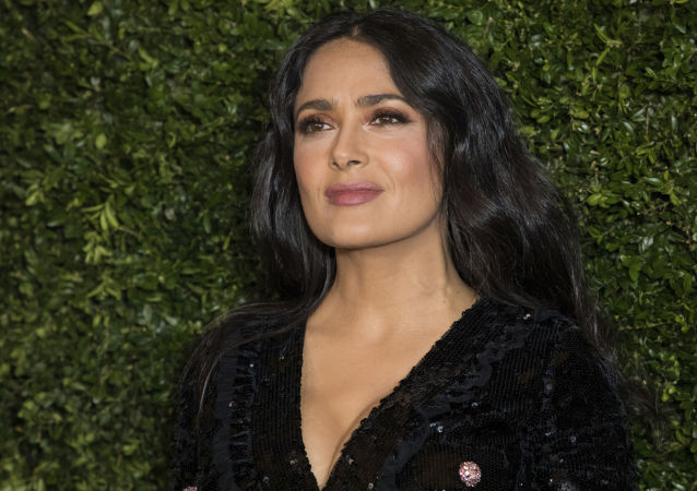 Salma Hayek poses for photographers upon arrival at the Finch Chanel Pre BAFTAs Dinner in London, Saturday, Feb. 9, 2019