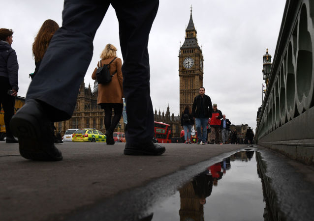 In this file photo taken on March 29, 2017 Commuters walks over Westminster bridge by the Houses of Parliament in central London on March 29, 2017.