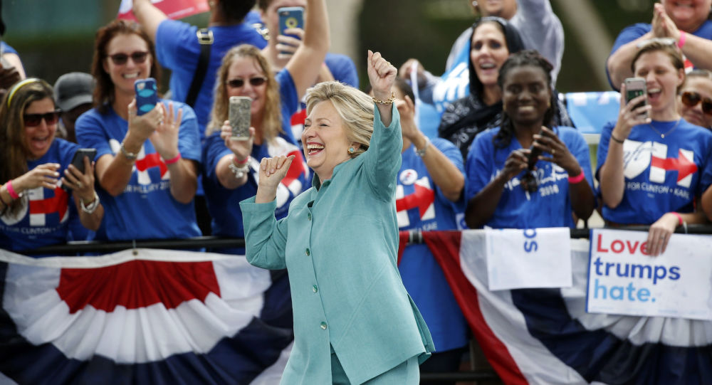 Democratic presidential candidate Hillary Clinton dances as she is introduced at a rally 5 November 2016 in Pembroke Pines Florida