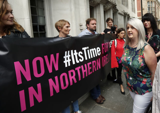 Campaigner Sarah Ewart (right) enters the UK Supreme Court in London to challenge Northern Ireland's strict anti-abortion laws