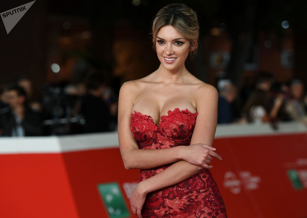 Actress Aurora Kaite on the red carpet before the premiere of Ron Howard's Pavarotti at the 14th Rome Film Festival.