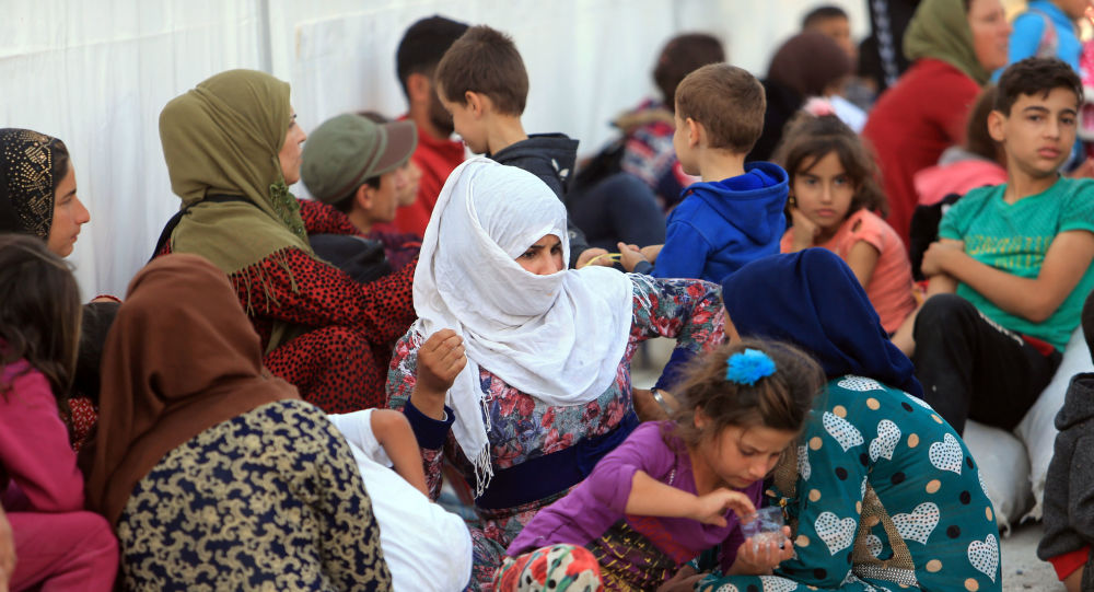 Syrian displaced families, who fled violence after the Turkish offensive in Syria, are seen at a refugee camp in Bardarash on the outskirts of Dohuk, Iraq October 25, 2019